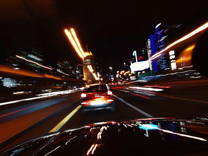 City Illuminated Road Nightlife Car Speed Light Trail Driving Land Vehicle Traffic Tail Light Auto Racing Overpass Elevated Road Fire Engine Headlight Highway Vehicle Light Multiple Lane Highway Motorsport Racecar