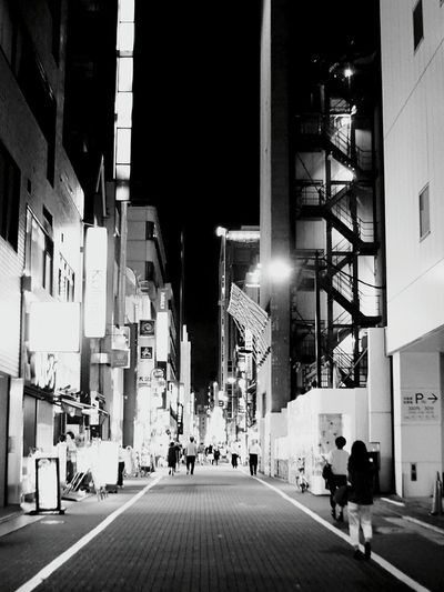 Night Illuminated City Travel Destinations Business Finance And Industry Architecture Modern People Full Length Skyscraper Building Exterior Adult Large Group Of People Outdoors Adults Only City Blackandwhitepics Cityscape Blackandwhite Blackandwhite Photography Monochrome World Monochrome _ Collection Blackandwhitephoto Blackandwhiteonly Blackandwhitephotos
