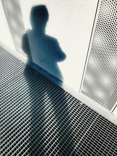 Real People One Person Shadow Women Low Angle View Outdoors Wall Grid Building Exterior Self Portrait IPhone7Plus Black & White