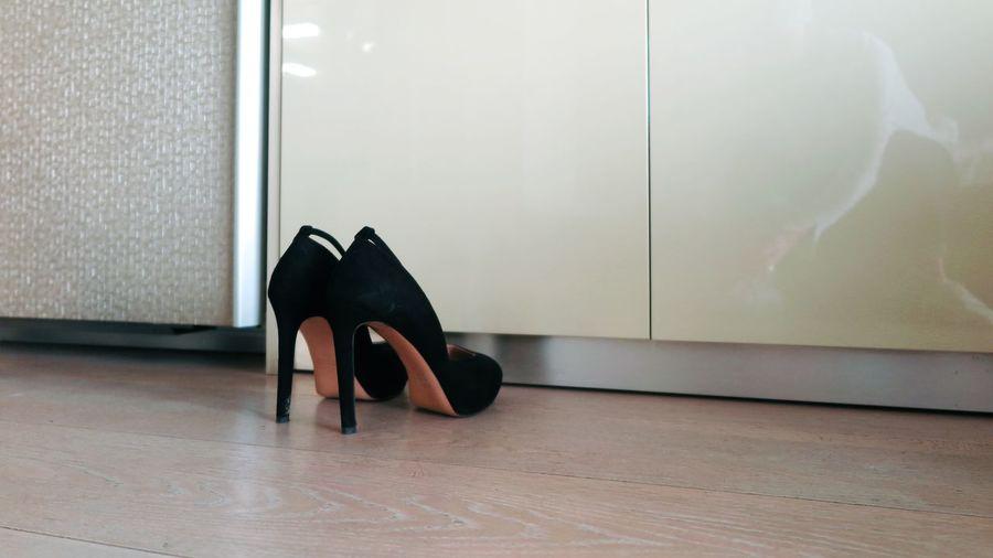 High heels on floor at home