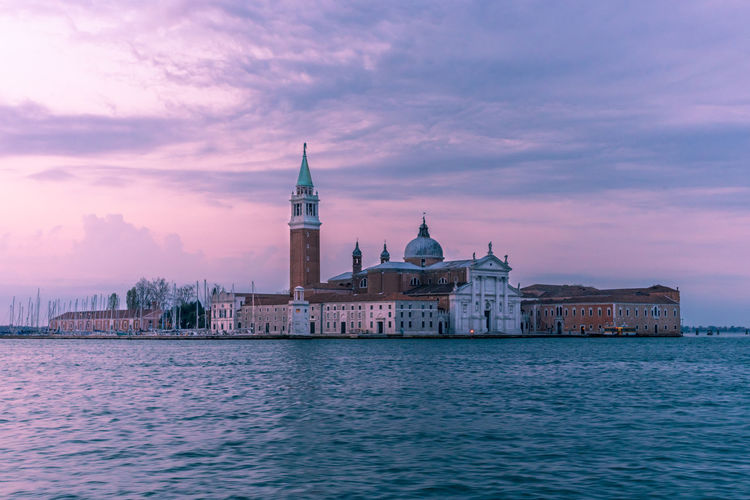 Church of san giorgio maggiore by grand canal during sunset in city