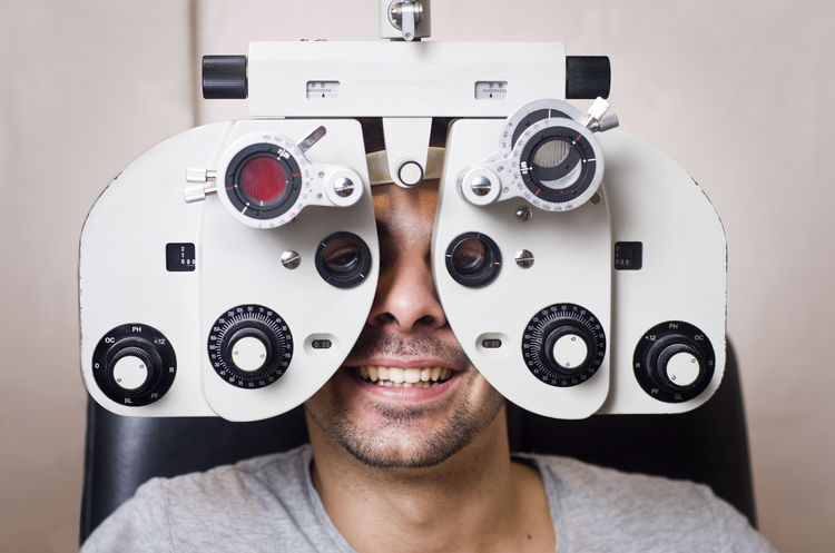 Man in eye test calibration, phoropter Adult Adults Only Business Doctor  Eye Exam  Eye Test Equipment Eyesight Glasses Healhty Healthcare And Medicine Human Eye Man Medical Clinic Medical Exam Men Miopia Ophthalmologist Optical Optometrist Optometry Patient Phoropter Store Test Vision