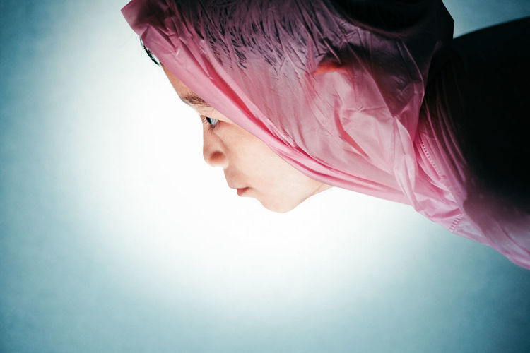 Rain Coat Pink People One Person Indoors  Side View Young Adult Pink Color Real People Lifestyles Studio Shot Looking Portrait Leisure Activity Close-up Profile View Backlight Looking Down Headshot Springtime Decadence
