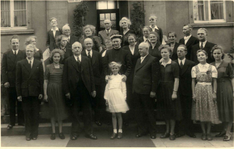Black and white family portrait of first holy communion, 1950 1950 Erstkommunion Adult Architecture Black And White Family Portrait Building Exterior Child City Crowd Females First Holy Communion Full Length Group Of People Large Group Of People Males  Men Mid Adult Real People Standing The Past Women Young Adult