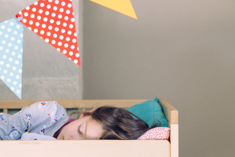 Cute girl sleeping on bed at home