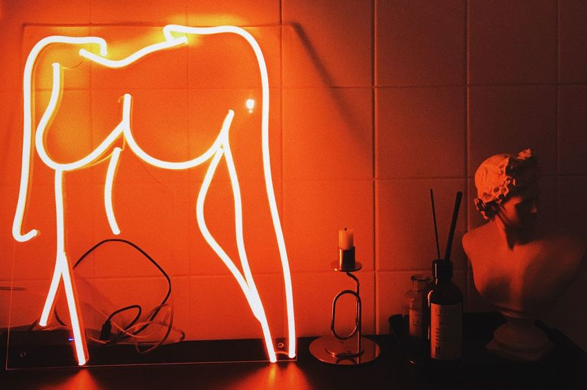 Art And Craft Cable Communication Creativity Domestic Room Electric Lamp Electricity  Glowing Home Interior Human Representation Illuminated Indoors  Light Light - Natural Phenomenon Lighting Equipment Music Night No People Orange Color Red Representation Wall - Building Feature