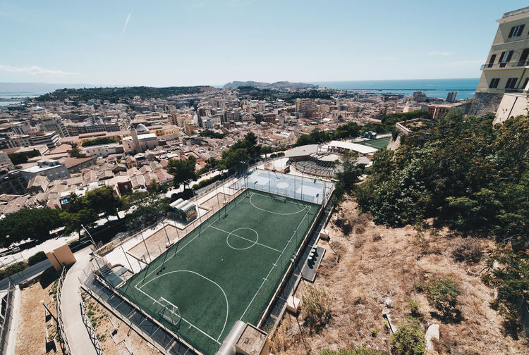 High Angle View Of Soccer Field And Buildings In City