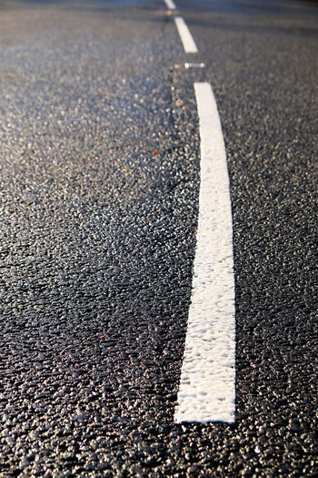 Curve Road Tarmac Road White Lines Asphalt Broken Line Broken Lines Close Up Communication Curves And Lines Day Guidance No People Outdoors Road Road Marking Road Trip Roadside Street Tarmac Tarmac Roads Transportation White Color
