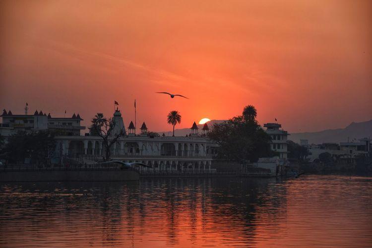 View of lake against orange sky