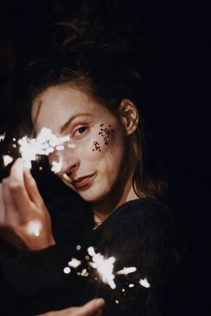 VSCO Vscoportrait PortraitPhotography Sparkler New Year Celebration Party EyeEm Selects Only Women Adults Only Headshot One Woman Only One Person Adult People Portrait Black Background Studio Shot Young Adult Make-up Beautiful Woman Close-up One Young Woman Only Young Women