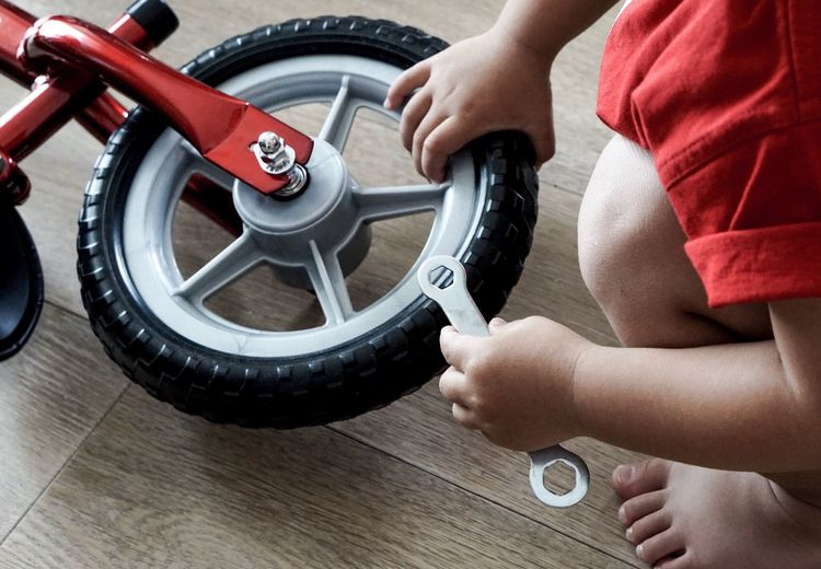Tire Wheel Transportation Mode Of Transport Human Hand Service Human Body Part Vehicle Part Mechanic Car Repairing Auto Repair Shop Land Vehicle Red One Person Pedal Occupation Gear Workshop Baby Hand Playing