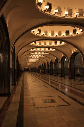 Moscow Metro Stations Subway Subway Station Architecture Arch Built Structure Illuminated Lighting Equipment Indoors  Building In A Row Travel Destinations Direction Architectural Column Travel Arcade Wine Cellar No People Subway Ceiling Flooring Light Fixture Cellar
