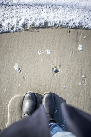 Beach Close-up Day Feet Human Leg Low Section Nature One Man Only One Person Outdoors People Personal Perspective Real People Sand Sea Sea And Sky Seashell Shoe Water Waterfront Wave