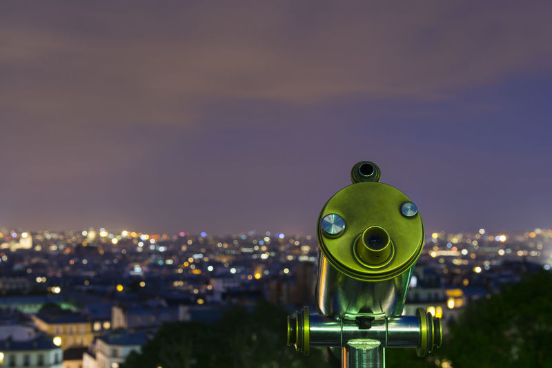 Telescope and panoramic view at the city of Paris from Sacre-Coeur Basilica at Montmartre, at night Binoculars Cityscape Cityscape Dusk Looking Montmartre, Paris Night Observation Panorama Panoramic View Parisian Rooftop Sacré Coeur, Paris Scenic Scope Silver  Sky Sky And Clouds Telescope Tourist Attraction  Travel Destinations Urban Urban Skyline Vacations Watching
