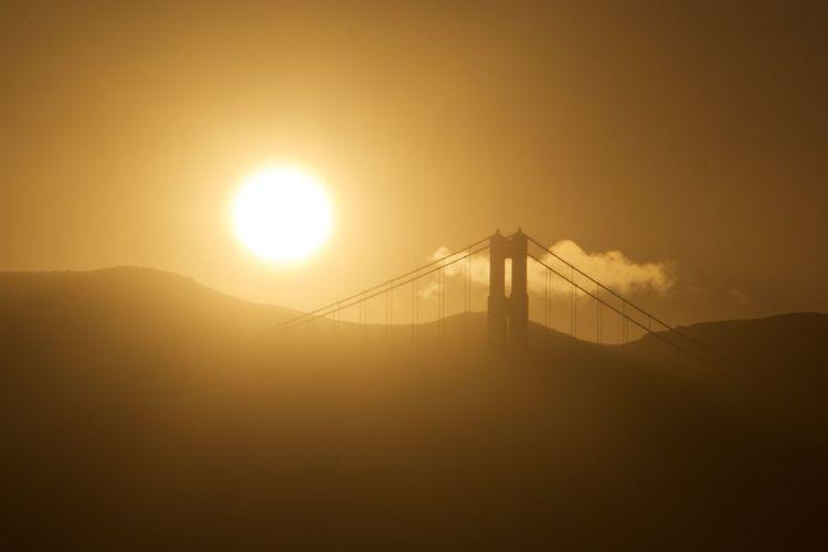 Scenic view of sunset at golden gate bridge