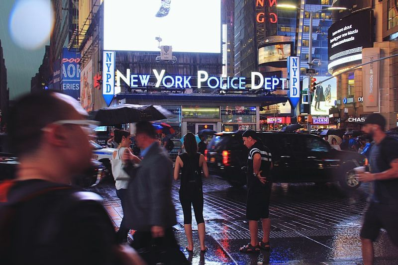 NYPD City City Life Illuminated Night Building Exterior Street Large Group Of People City Street Text Architecture Communication Crowd Nightlife Outdoors Neon Men Real People People Adult