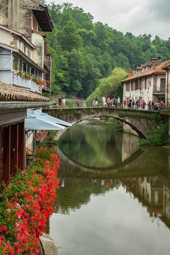 Beautiful medieval french town No People Building Exterior Architecture Built Structure Water Reflection House Nature Tree Waterfront Outdoors Tranquility Beauty In Nature Growth Residential Building Day Mountain Scenics Flower Footbridge