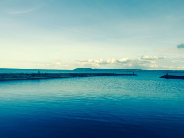 Sea Water Tranquil Scene Scenics Blue Tranquility Horizon Over Water Waterfront Sky Beauty In Nature Calm Seascape Nature Vapor Trail Day Non-urban Scene Outdoors Coastline Cloud - Sky Ocean Lake Majestic