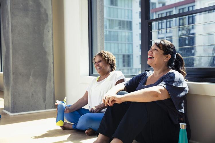 Women sitting on window
