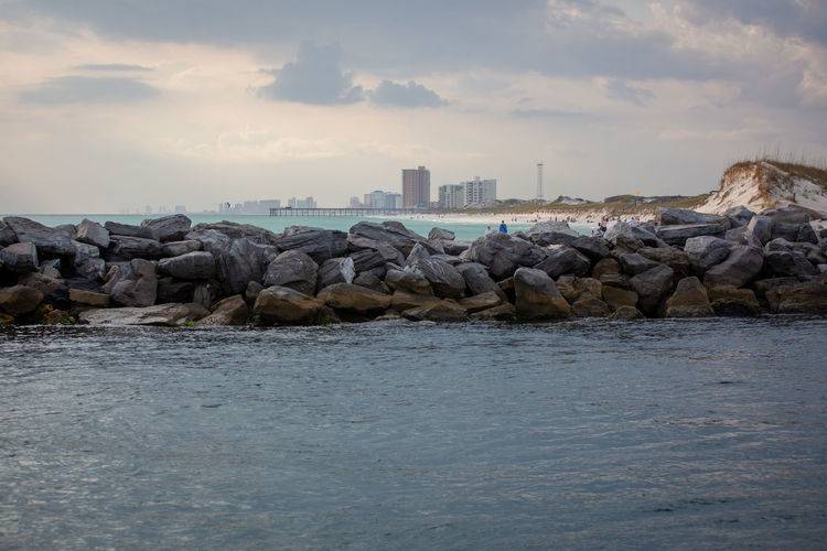 Architecture Beach Beauty In Nature Building Exterior Built Structure Cloud - Sky Day Groyne Land Nature No People Outdoors Rock Rock - Object Scenics - Nature Sea Sky Solid Tranquil Scene Water Waterfront