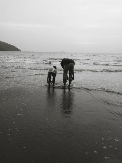 Water Beach Sea Walking Two People Wet People Dog Adult Togetherness Sand Full Length Outdoors Men Nature Farmer Beauty In Nature Sunset Low Tide Pets Father And Son Fatherhood Moments Father And Son Time FatherSonMoments TCPM