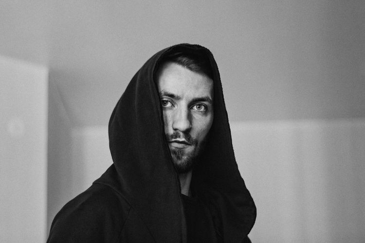 One Person Headshot Young Men Young Adult Front View Real People Beard Lifestyles Looking At Camera Portrait Facial Hair Indoors  Leisure Activity Men Hood Mid Adult Men Serious Looking Contemplation Mustache Hood - Clothing Human Face Blackandwhite Black And White Black Black & White Black Background
