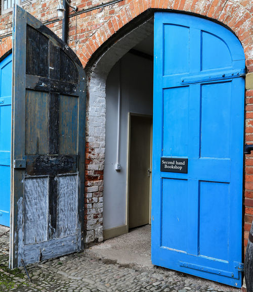Lovely place to buy/sell books. Architecture Blue Bookshop Building Exterior Built Structure Closed Day Door Entrance Herefordshire No People Open Door Outdoors Sign Wording