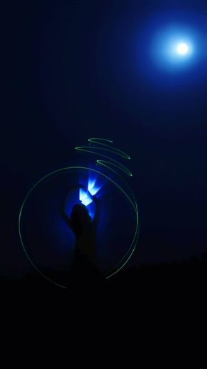 Light painting against blue sky at night