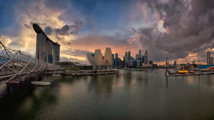 Sunset in the City at Marina Bay, Singapore cityscapes City Landscape Marina Bay Tourism Singapore Waterscape Singapore Tourism Destination Tourism EyeEm Selects Building Exterior City Architecture Built Structure Sky Water Building Cloud - Sky Office Building Exterior Cityscape Travel Destinations Urban Skyline Landscape Sunset Outdoors Modern City Life EyeEmNewHere