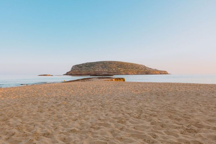 EyeEm Selects Sea Beach Sand Nature Clear Sky Horizon Over Water Beauty In Nature Scenics Tranquility Water Tranquil Scene Blue Outdoors Day No People Sky Cala Conta Ibiza Sunlight Beauty In Nature Low Angle View