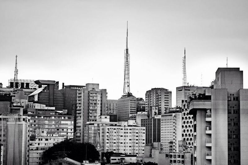 """""""Um labirinto místico onde os grafites gritam, não dá pra descrever numa linda frase de um postal tão doce. São Paulo é um buque, buque são flores mortas num lindo arranjo, arranjo lindo feito pra você"""" Não existe amor em SP - Criolo Concrete Cıty Life São Paulo Brazil Sao Paulo - Brazil Architecture Built Structure Building Exterior City Building Sky Tall - High Cityscape Tower Office Building Exterior Clear Sky Travel Destinations Residential District Skyscraper No People Day Spire  Modern Outdoors"""