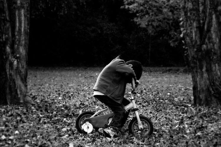 Close-Up Of Boy On Bicycle