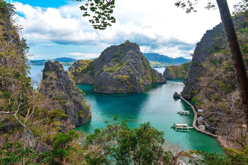 EyeemPhilippines Coron, Palawan Scenics - Nature Day Mountain Tranquility Tranquil Scene Growth No People Non-urban Scene Rock Outdoors Sea Mountain Range Turquoise Colored Going Remote