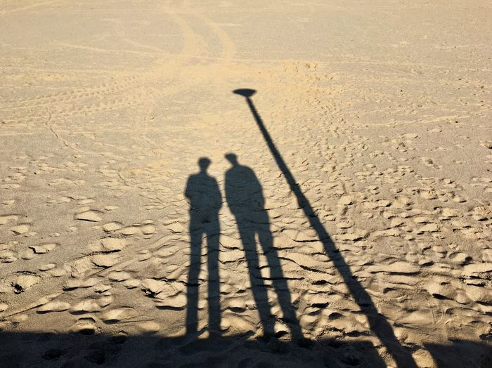 Two People Shadow Outdoors Beach Sand Standing Streetlight The City Light