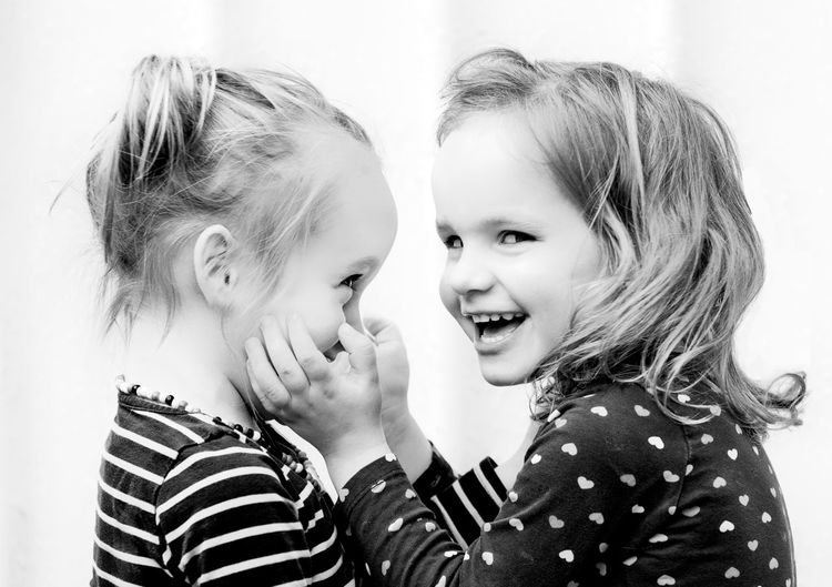 Sisters Kids Of EyeEm Children Children's Portraits Fun Hug Kids Kids Being Kids Laughing Sisters Bonding Child Childhood Emotion Family Girl Girls Happiness Kid Love Portrait Positive Emotion Sister Smiling Togetherness Twins Two People EyeEmNewHere The Portraitist - 2018 EyeEm Awards
