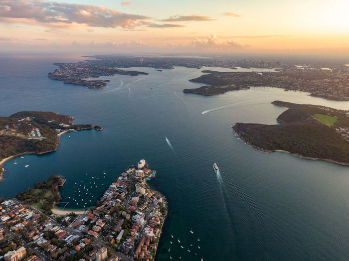 Aerial drone evening view of the Sydney suburb of Manly, a beach-side suburb of northern Sydney, in the state of New South Wales, Australia. Sydney Harbour with North Head & South Head in background. Sydney Sydney, Australia Sydney Harbour  Manly  Manly Beach New Shoes Australia Harbour Harbour View North Head North Head Sydney South Head Evening Sunset Aerial View Aerial View Panoramic Drone  Drone View Boat Water Sea Architecture Built Structure Nature Building Exterior Transportation High Angle View Beauty In Nature Nautical Vessel Sky City Scenics - Nature No People Outdoors Travel Tranquility Cityscape