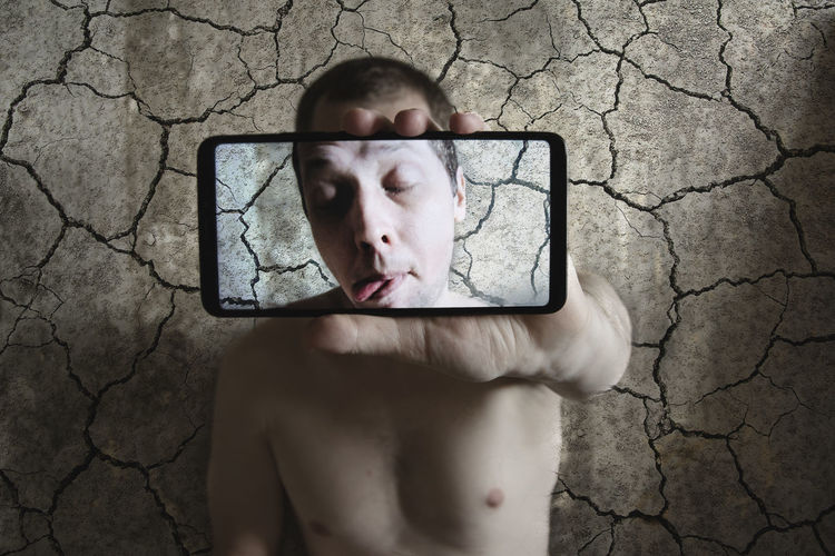 One Person Portrait Shirtless Technology Headshot Front View Wireless Technology Men Communication Holding Cracked Indoors  Body Part Wall - Building Feature Selfie Human Face Personal Perspective Grimace Lifestyle Emotions Self Portrait Males  Multiple Exposure Screen Through My Phone