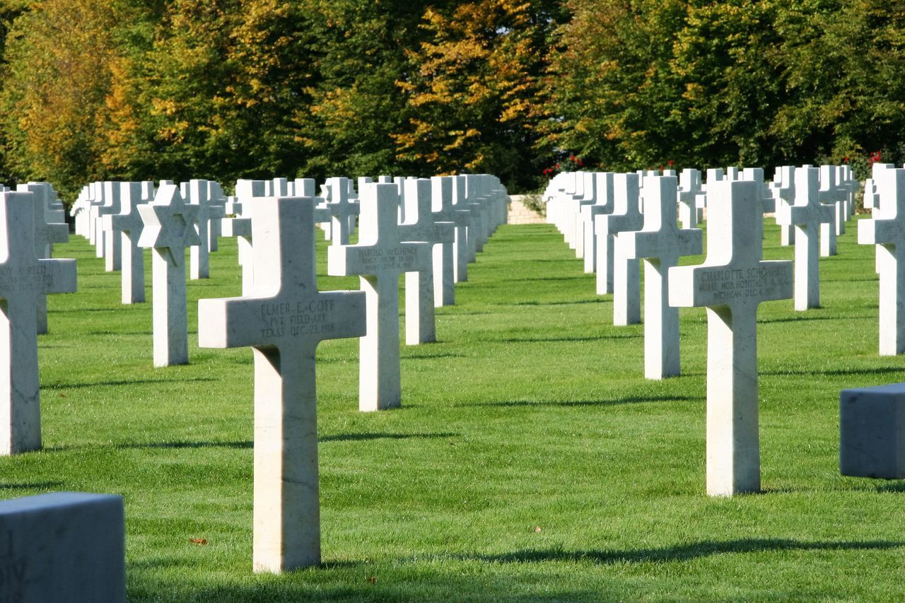 tombstone, cemetery, memorial, grass, in a row, green color, grave, day, tree, no people, war, outdoors, gravestone, graveyard, military, landscape, nature
