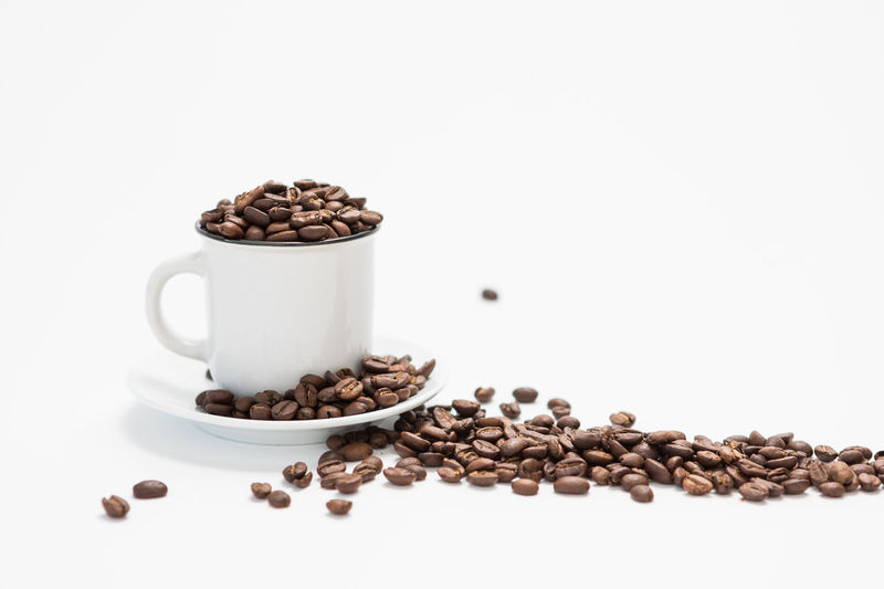 White Coffee Cup Filled with Coffee Beans on a white Background Concept Food And Drink White Background Coffee - Drink Roasted Coffee Bean Still Life Coffee Indoors  Studio Shot Food Freshness Coffee Bean No People Cup Brown Large Group Of Objects Coffee Cup Mug Copy Space Close-up Drink