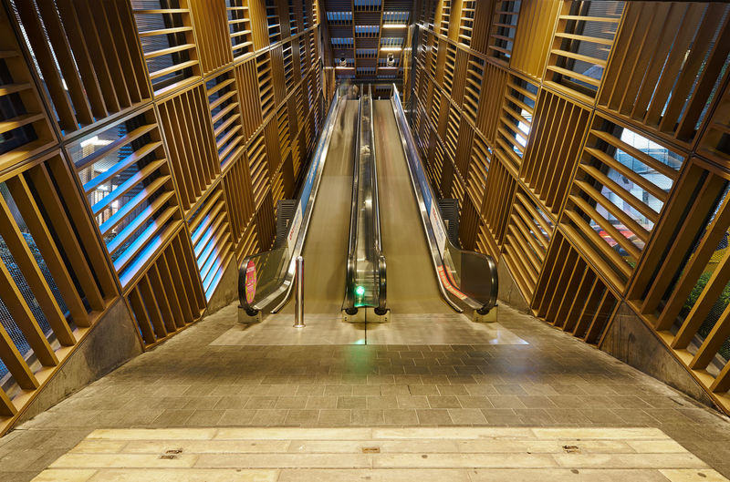 Architecture Indoors  Illuminated Built Structure Staircase The Way Forward Direction Transportation Railing Steps And Staircases Modern Lighting Equipment Escalator No People Building Technology Diminishing Perspective Absence Subway Station Tiled Floor Ceiling Luxury