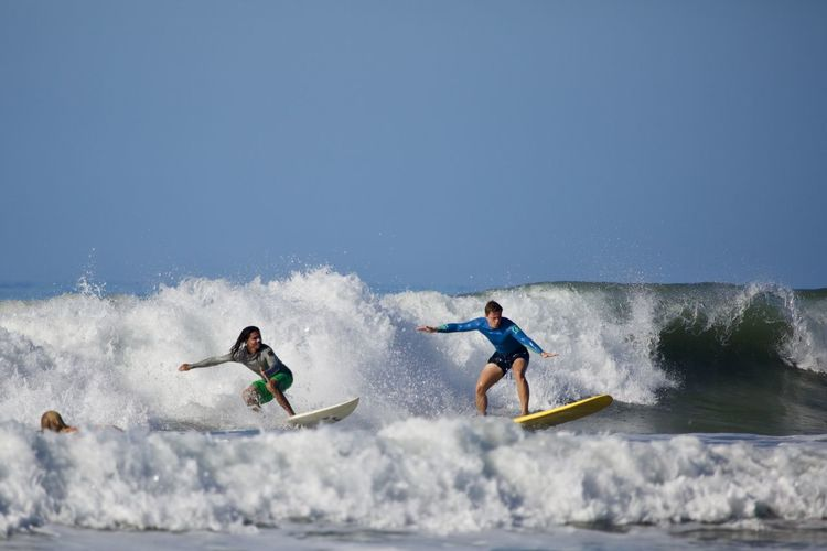 Motion Sport Water Sea Wave Full Length Nature Sky People Splashing Copy Space Surfing Two People Clear Sky Day Leisure Activity Men Skill  Adventure Vitality Outdoors