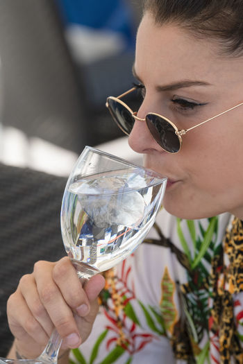 Close-up of woman drinking glass