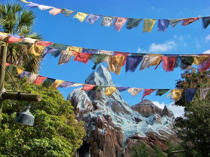 Low angle view of clothes drying against sky