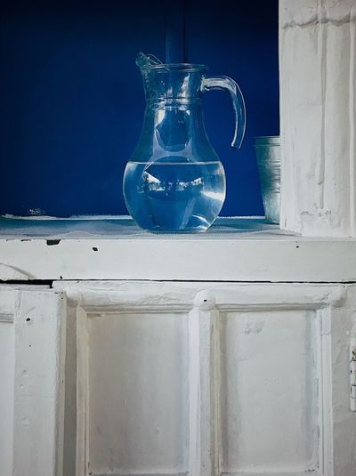 Glass pitcher in a white cupboard with blue background Glass Bowl Glass Jar Blue Background Buffet Cupboard Jar White Glassware Glass Objects  Glass - Material Glass Pitcher Glass Pitcher Of Water Pitcher Pitcher - Jug Blue No People Food And Drink Indoors  Drink Household Equipment Close-up Glass - Material Still Life Transparent Refreshment Freshness Day Water Container