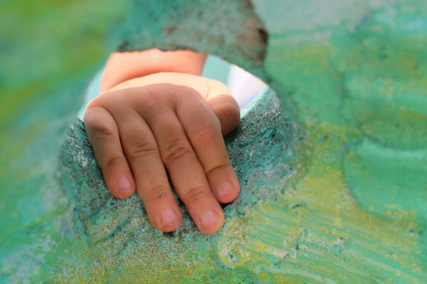close up on child's hand on a playground structure Childhood Close-up Day Golden Gate Park Green Color Human Body Part Human Hand Indoors  Koret Children's Quarter Leisure Activity Lifestyles One Person Real People Water