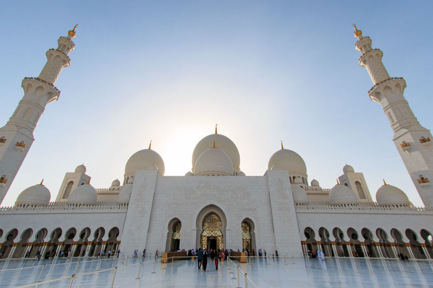Sheikh Zayed mosque in Abu-Dhabi Abu Dhabi Arabic Arcade Arch Arched Architecture Blue Building Exterior Built Structure Clear Sky Dome Façade Faith Grand Mosque Islam Mosque People Person Place Of Worship Religion Sheik Zayed Mosque Spirituality Travel Destinations United Arab Emirates White Mosque