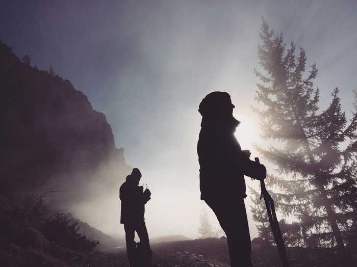 Silhouette Of Couple On Mountain