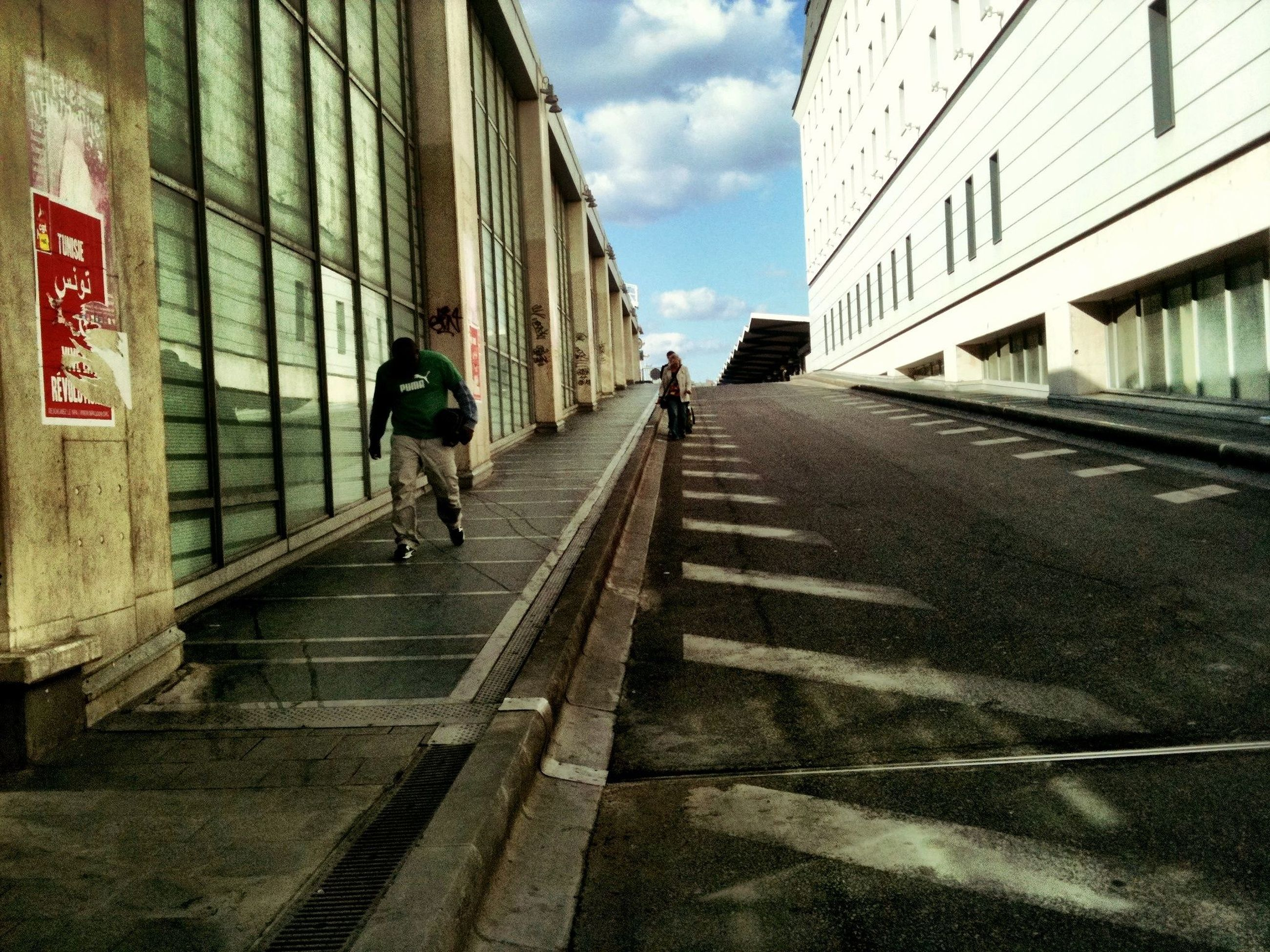 sky, built structure, building exterior, architecture, the way forward, men, full length, walking, lifestyles, cloud - sky, transportation, cloud, diminishing perspective, leisure activity, street, day, city, person