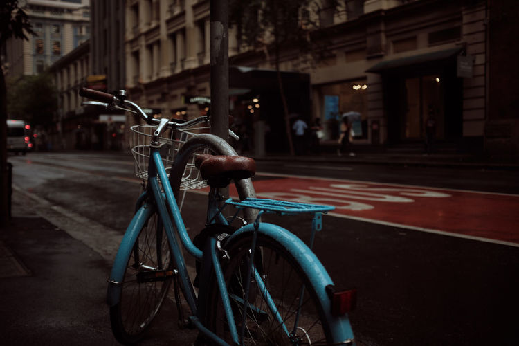 Bicycle parked on street in city