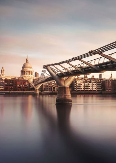 A long exposure of the millennium bridge and St Paul's cathedral at sunrise. Architecture Bridge - Man Made Structure Building Exterior Built Structure City Cityscape Connection Day L Long Exposure Millennium Bridge No People Outdoors Reflection Rippled River Sky St Paul's Cathedral Sunrise Sunset Thames Travel Travel Destinations Vertical Water